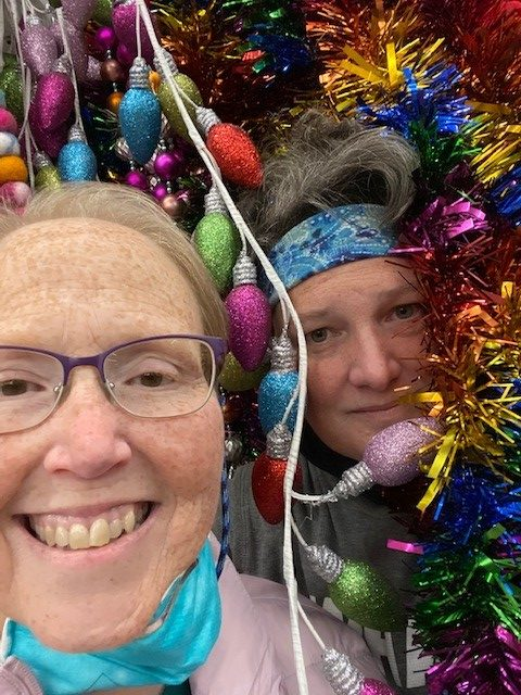Two women surrounded by Christmas ornaments